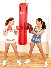 Two boxing lezzies toying their pussy together in the gym