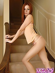 Kori bent over on the stairs