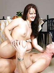 Brunette beauty seduces an old senior during her breakfast
