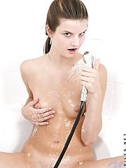 Hottie in the shower watch carolina get all nice and wet spraying the water all over her tiny boobies and pussy