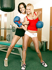 Two cute lesbian girlies love to get naughty in the gym