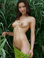 Sexy Asian babe showing her perfect goodies in the nature