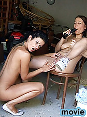Two brunette lesbo teens using big dildo to fuck eachother