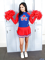 Flirtatious horny cheerleader pulls up her red skirt and bares her alluring tight teen hole