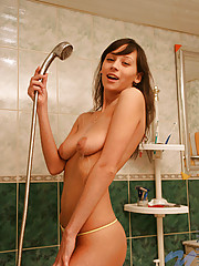 Gorgeous stunner szilvia loves to pinch her cute pink nipples before she gets totally wet in the shower