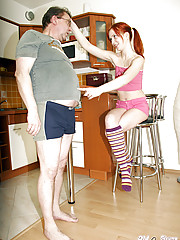 Senior banging a naughty teenage redhead in the kitchen