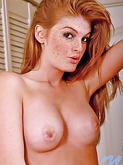 Long haired redhead faye letting us peek into her succulent hooters