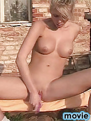 Sexy blonde plays with herself than stuffs dildo up her puss