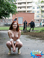 Horny passers-by watch a young babe flashing pussy