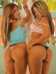 The Twins show off their matching round asses