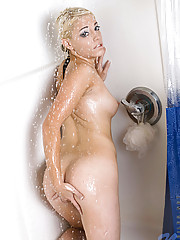 Wet nubile babe Kody having fun washing her fresh naked body in her bathroom