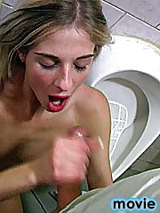 Cute blonde teenager pleasing big cock at a public toilet