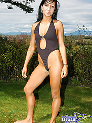 Trista strips off her sexy black body suit outdoors