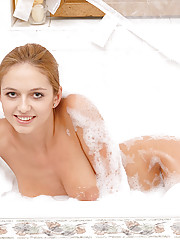 Smooth skinned Daggy Jane in a bubble bath pictorial while pampering her perky assets