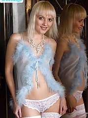 Blonde sweetie in sexy blue peignoir and stockings