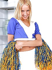 Hot horny cheerleader masturbates with a big blue dildo