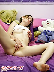 Yummy teenie shows her shaved pussy