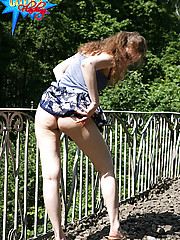 Young girl flashes her upskirt on railway bridge