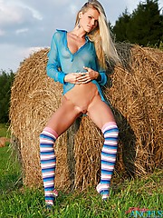 Stunning blonde angel showing her body on a farm outdoor