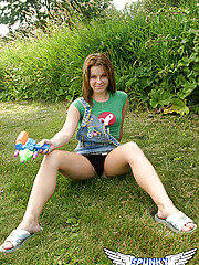 18 year old Kandie spends a day in the park and shows off her panties