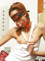Masked tiny titted young redhead posing