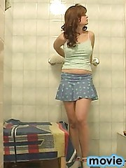 Tempting teenie getting undressed in the bathroom