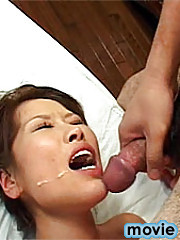Japanese girl enjoys the taste of his big load of semen