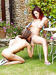 Two cute teenage girlies toying eachother in the backyard