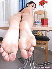 She plays with her sexy silky bare feet