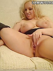 Big breasted blonde abuses her pussy as hard as she can with huge toys