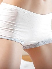 Pigtailed blonde takes off her underwear