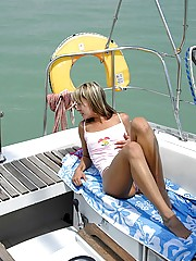 Petite teenage blonde pleasing a stiffy cock on his boat