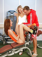 Sexy sporty sweethearts sucking a guys stiff dick at gym