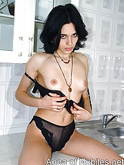 Nubile sheds clothes to get fucked in kitchen