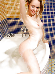 Beautiful brunette Virgina washes her cute tits and tender pussy in the bathroom