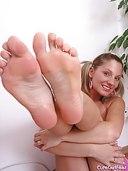 Teen plays with her feet on the floor