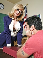 Horny milf teacher takes advantage of her student