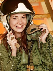 Brunette teenage fighterpilot showing her firm round body