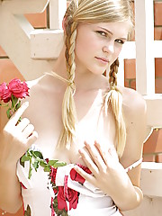 Teen model Joss with a big rose