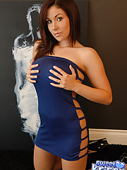 Krissys huge tits are barely staying in her blue mini dress