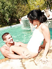 Teenage cutie loves milking a big stiffy cock in the pool