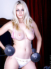 Jess pretty tough lifting a dumbbell and display her huge yummy boobies